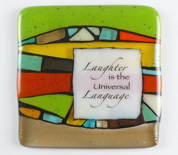"""Laughter is the universal language"" fused glass quote tile by Nina Cambron"