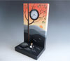 "Link to ""Sunset Romance"" clock by Pascale Judet"